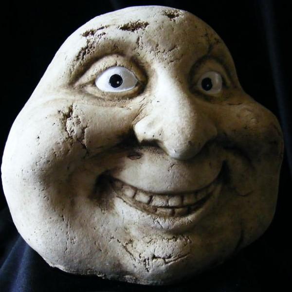 stone man smiling